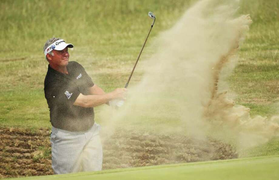 SANDWICH, ENGLAND - JULY 15:  Darren Clarke of Northern Ireland hits from a bunker on the 16th hole during the second round of The 140th Open Championship at Royal St George's on July 15, 2011 in Sandwich, England.  (Photo by Andrew Redington/Getty Images) Photo: Andrew Redington, Getty / 2011 Getty Images
