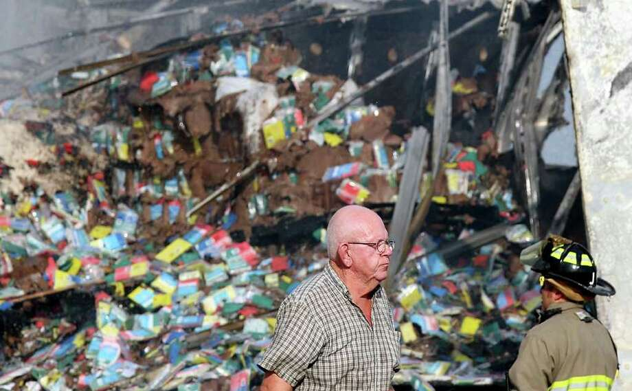 Edwin Trammell, the driver of the 18-wheel tractor-trailer, passes the scene after a vehicle became caught under the semi causing a fire on I-35 North at the AT&T Center Parkway exit Friday. The female driver of the vehicle was killed. Photo: EDWARD A. ORNELAS, Edward A. Ornelas/Express-News / © SAN ANTONIO EXPRESS-NEWS (NFS)