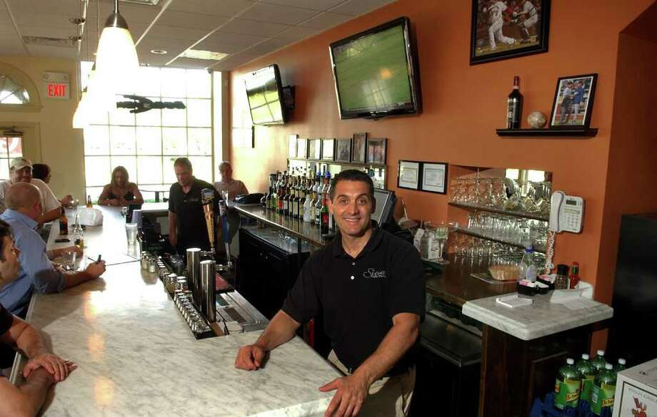 Owner Dean Marrazzo poses at the new restaurant Siena Italian Trattoria in downtown Stratford, Conn. on Friday July 15, 2011. Photo: Christian Abraham / Connecticut Post
