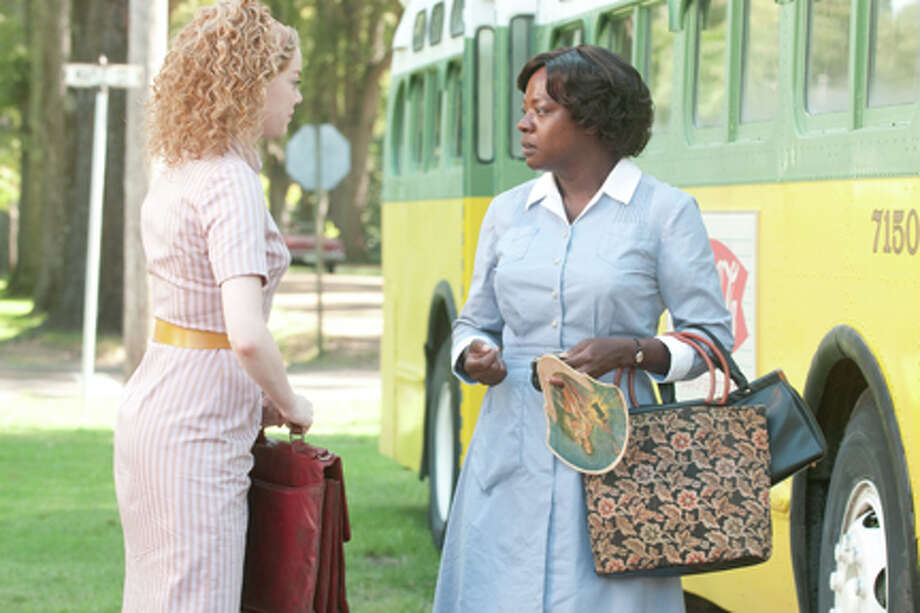 """(L-R) Emma Stone as Skeeter and Viola Davis as Aibileen Clark in """"The Help."""" Photo: Dale Robinette / ©DreamWorks II Distribution Co., LLC. All Rights Reserved."""