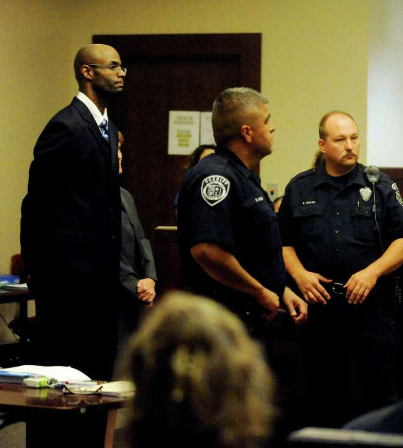 Breck Ross, a former basketball coach at Antonian High School, listens as the father of his victim makes an impact statement. He was sentenced to five years confinement after pleading no contest to a charge of improper relationship between an educator and a student on Friday, July 15, 2011. Extra bailiffs were brought into the courtroom because of the vocal crowd. Photo: BILLY CALZADA, BILLY CALZADA / Gcalzada@express-news.net / gcalzada@express-news.net