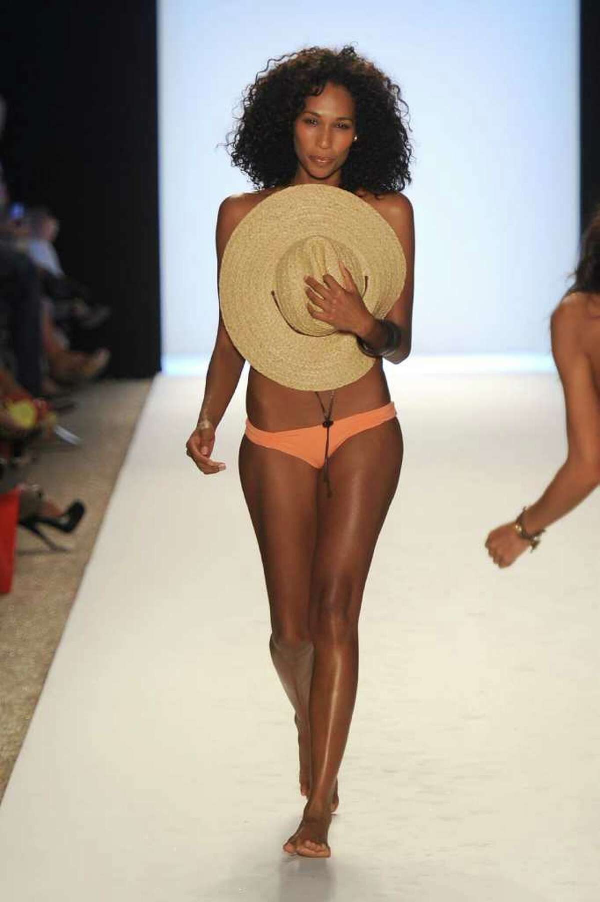 A model walks the runway at the L*SPACE BY MONICA WISE show during Mercedes-Benz Fashion Week Swim at The Raleigh in Miami Beach, Fla., on Friday, July 15, 2011.