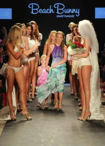 MIAMI BEACH, FL - JULY 15:  Designer Angela Chittenden, daughter Presley and model Kate Upton walk the runway at the Beach Bunny Swimwear show during Mercedes-Benz Fashion Week Swim at The Raleigh on July 15, 2011 in Miami Beach, Florida. Photo: Frazer Harrison, Getty Images For Mercedes-Benz / 2011 Getty Images