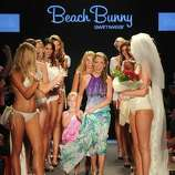 MIAMI BEACH, FL - JULY 15:  Designer Angela Chittenden, daughter Presley and model Kate Upton walk the runway at the Beach Bunny Swimwear show during Mercedes-Benz Fashion Week Swim at The Raleigh on July 15, 2011 in Miami Beach, Florida.