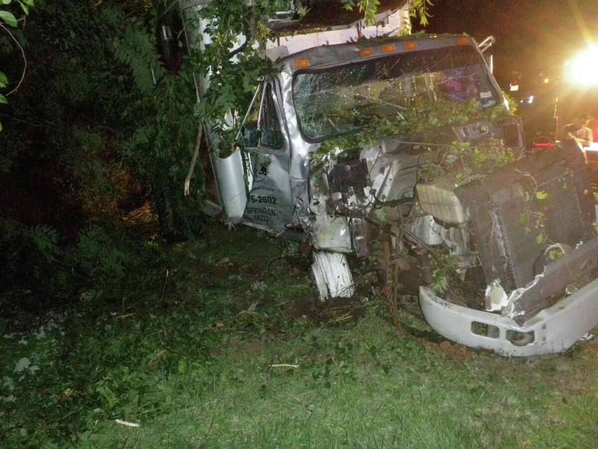 This box truck crashed into trees late Friday on Interstate 95 in Westport, but the driver had only minor injuries.