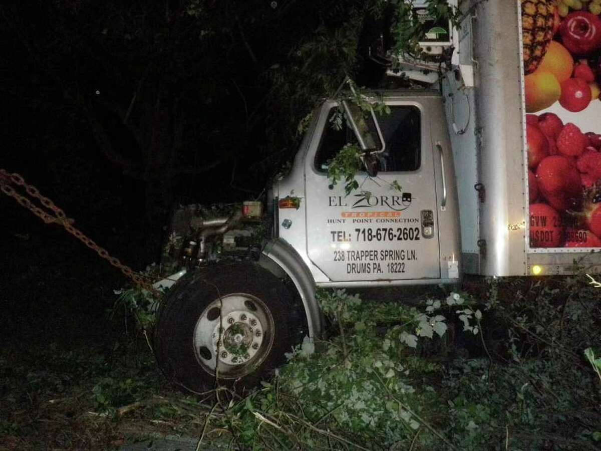The cab of this truck, carrying food on Interstate 95, was heavily damaged after the vehicle left the highway in Westport on Friday night.