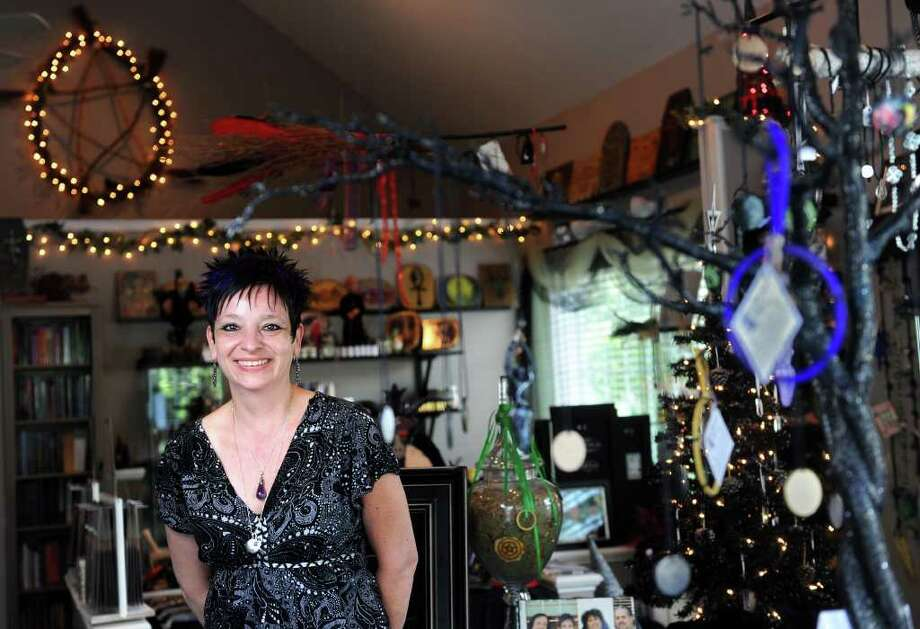 Co-owner Donna Golias stands among her wares at Effigy Witch Shoppe, on Main Street in Monroe, Conn. Photo: Autumn Driscoll / Connecticut Post