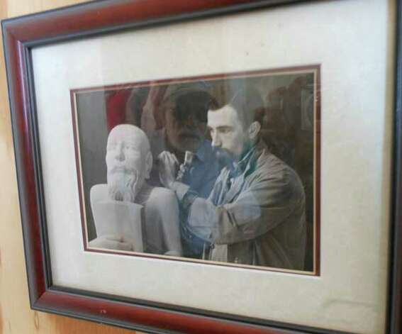 Phil Evett as a young sculptor in the 40s, with his reflection now.