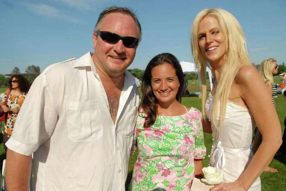 """Jen Danzi, center, organizer of the Victory Cup at Greenwich Polo Club, with """"White House party crashers"""" Tareq and Michaela Salahi. (John Ferris Robben/For Greenwich Time) Photo: Contributed Photo"""