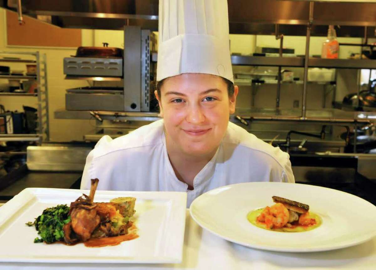 SCCC culinary student Caitlin Sive with menu she is preparing as one of four finalists competing for a national title from the American Culinary Federation at the college in Schenectady Thursday July 7, 2011.