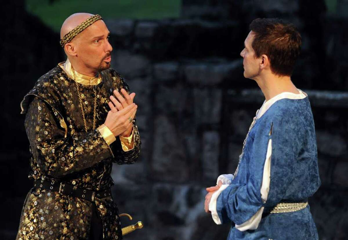 Mark Frattaroli as Leontes, left, and Miles Everett as Camillo, right, perform during The Players at Putney Gardens' production of The Winter's Tale at Boothe Memorial Park in Stratford on Saturday, July 16, 2011.