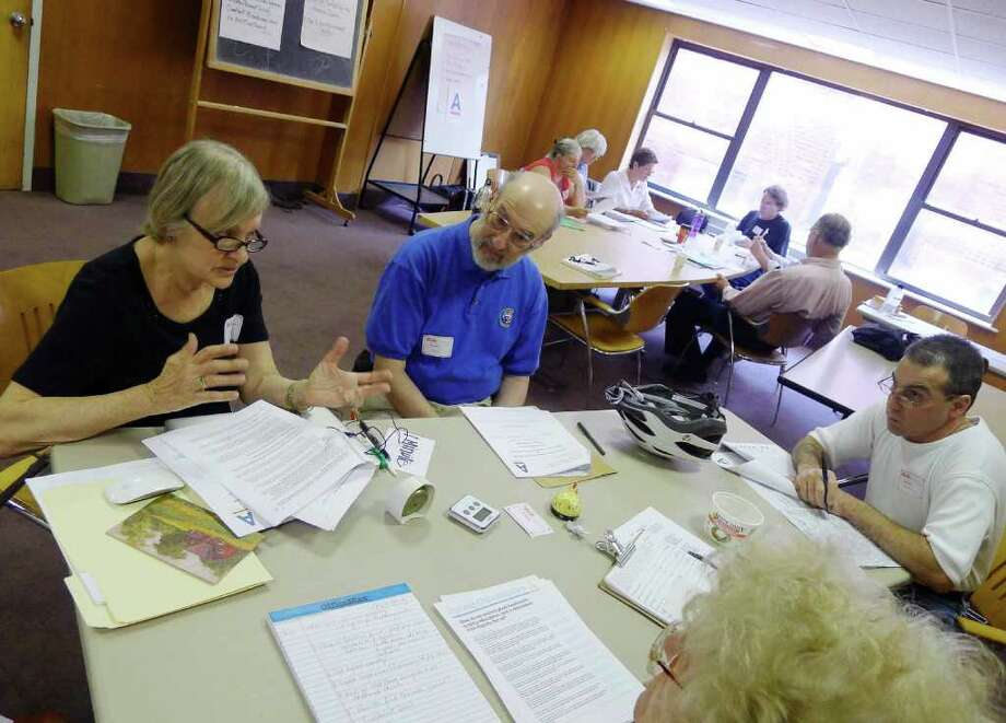 Lisa Barron,left, co-host of an organizational meeting of political activists to mount a response to the Tea Party at the main branch Albany Public Library in Albany,NY Saturday July 16,2011.( Michael P. Farrell/Times Union ) Photo: Michael P. Farrell / 00013951A