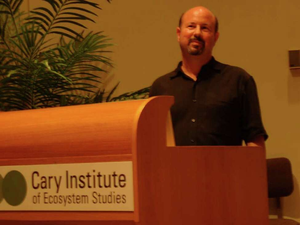 Penn State University climate researcher Michael Mann speaks Friday at the Cary Institute of Ecosystem Studies in Millbrook, Dutchess County.