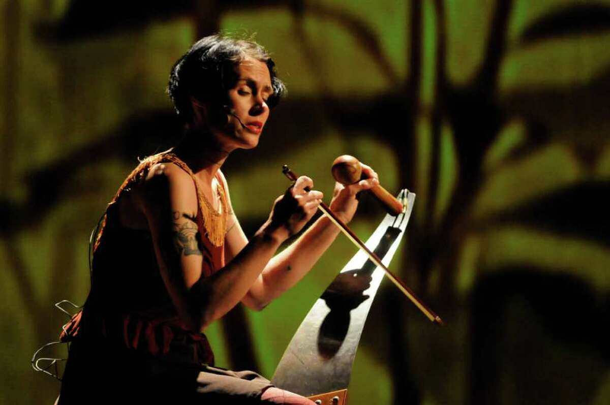 C.Ryder Cooley plays the saw during her production of XMALIA Songs About Extinction at Proctors Theater in Schenectady,NY Friday July 15,2011.( Michael P. Farrell/Times Union )
