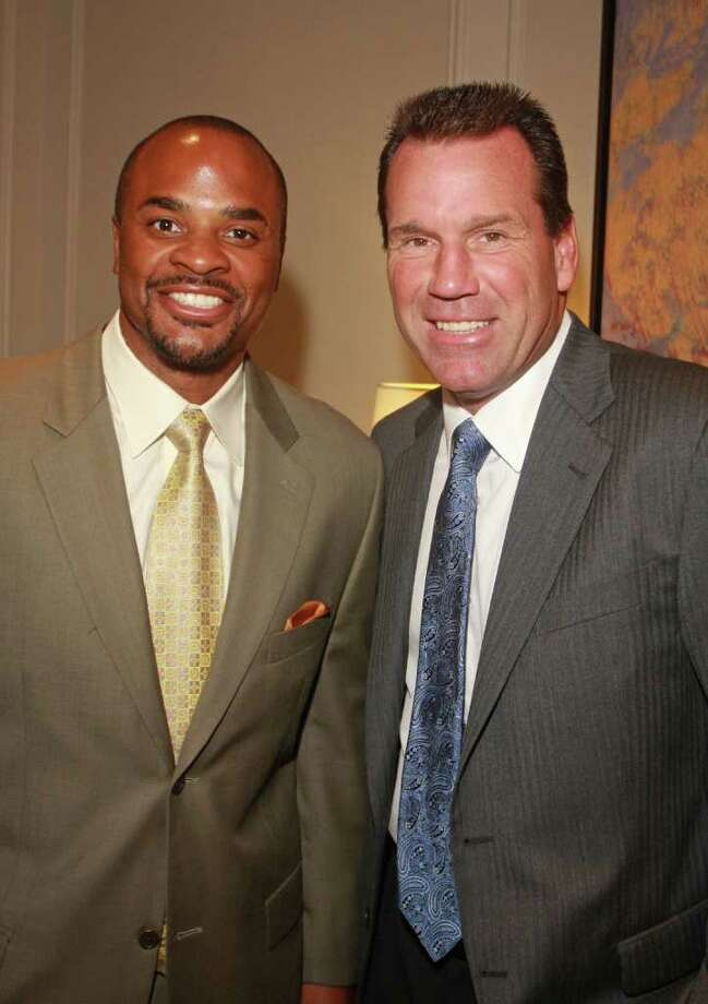 (For the Chronicle/Gary Fountain, August 31, 2010)  Houston Texans general manager Rick Smith, left, and Coach Gary Kubiak at the 2010 Season Kick-off Luncheon benefiting the Houston Texans Foundation. Photo: Gary Fountain, Freelance / Freelance