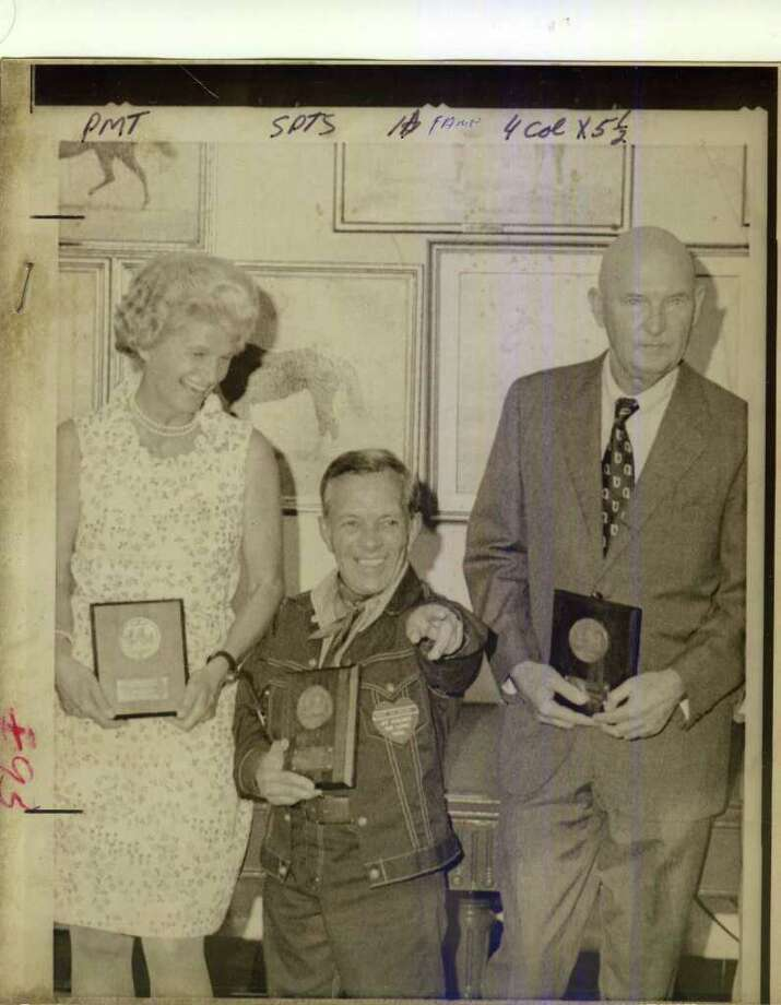 Here is the class of 1974 for the National Museum of Racing and Hall of Fame. From left to right: owner Penny Tweedy (accepting for 1973 Triple Crown winner Secretariat), jockey Conn McCreary, and trainer Charlie Whittingham.  (Times Union Archives)