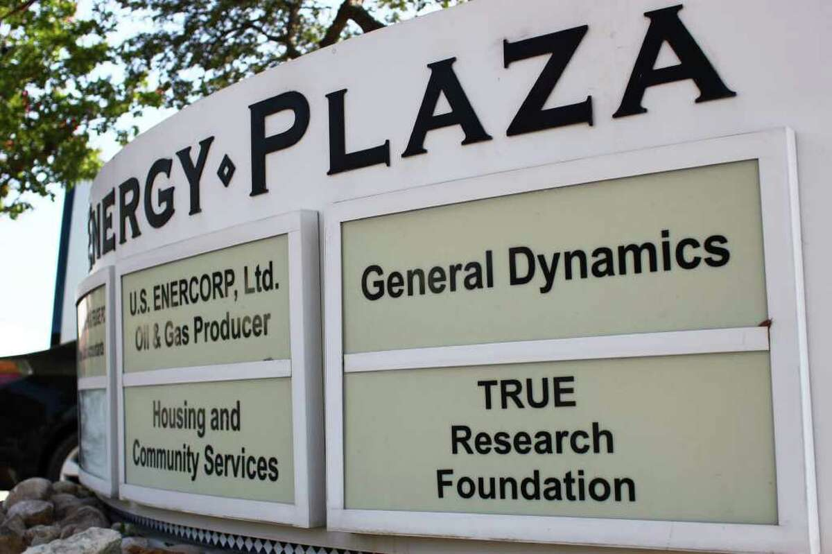 A sign still informs visitors to an office building at Energy Plaza that it houses the headquarters of the T.R.U.E. Research Foundation. Suite 705, where the headquarters were located, now is empty.
