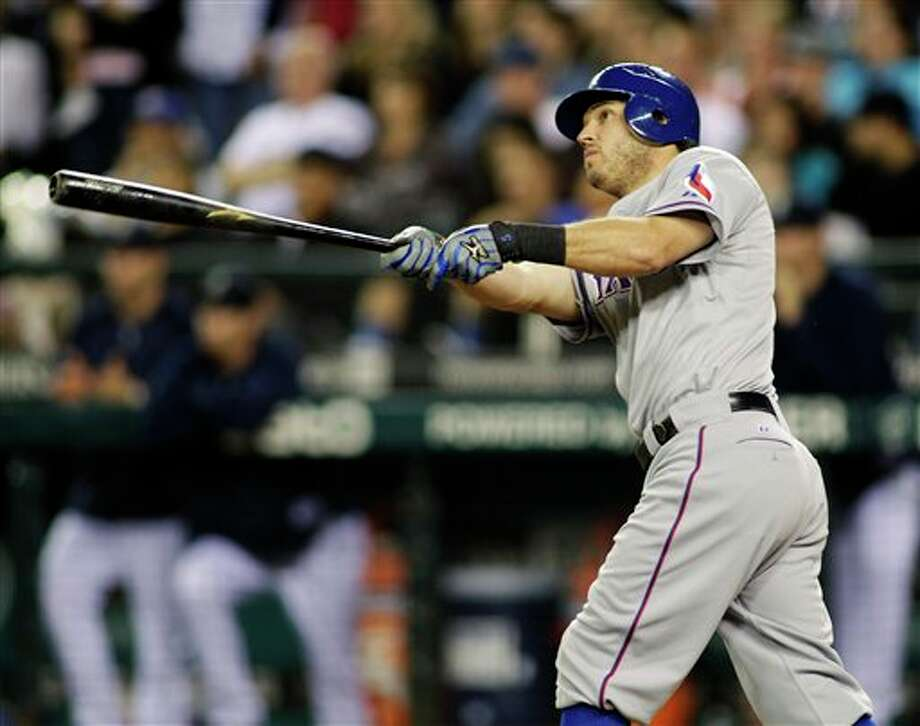 Texas Rangers' Ian Kinsler watches his solo home run in the eighth inning of a baseball game against the Seattle Mariners, Saturday, July 16, 2011, in Seattle. It was Kinsler's second home run of the game. (AP Photo/Ted S. Warren) Photo: Ted S. Warren, Associated Press / AP