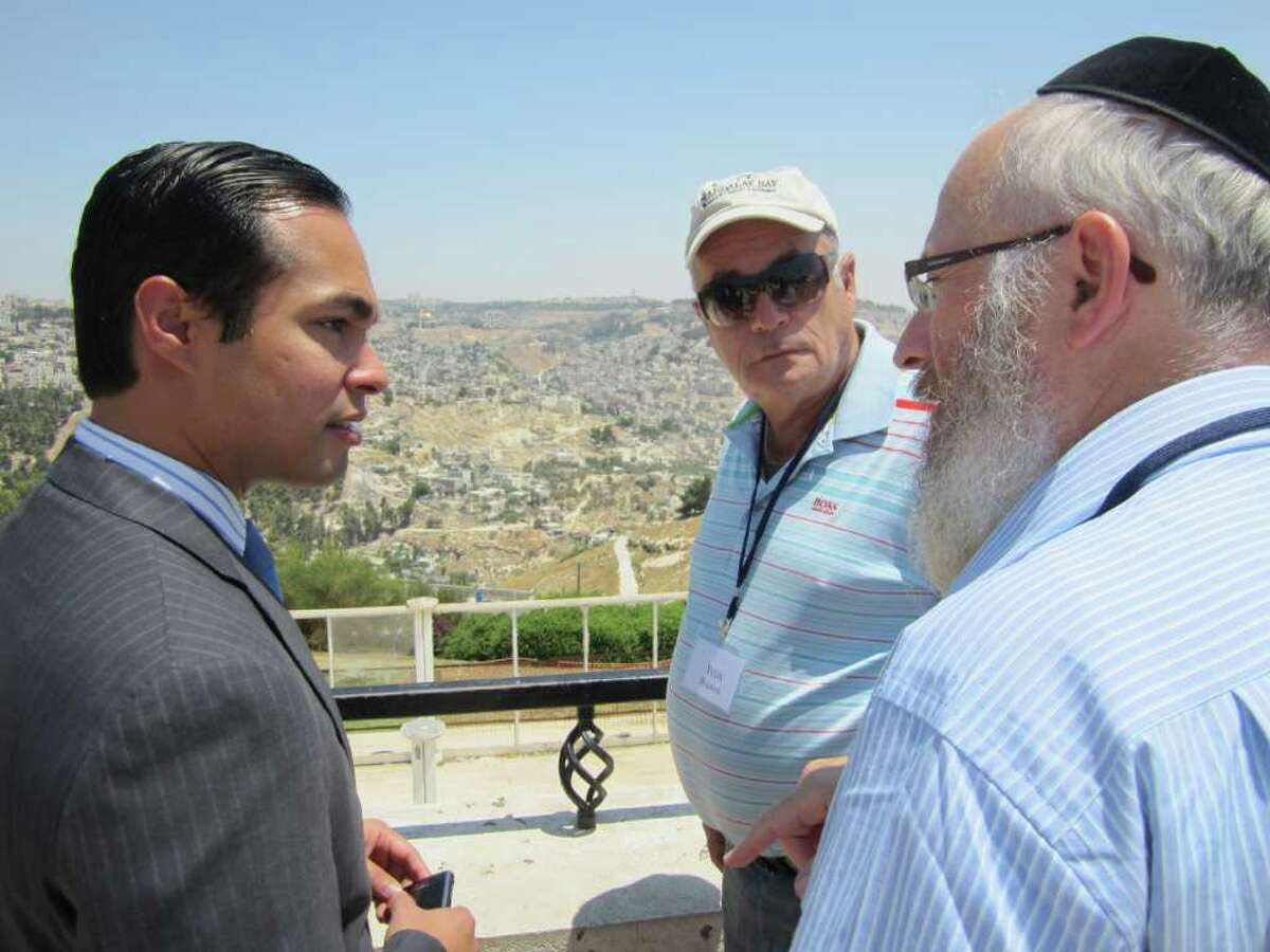 While in Israel, Mayor Julián Castro (from left) talks with Yuda Doliner of Sun Freedom America and Rabbi Chaim Block of Chabad Lubavitch of South Texas.