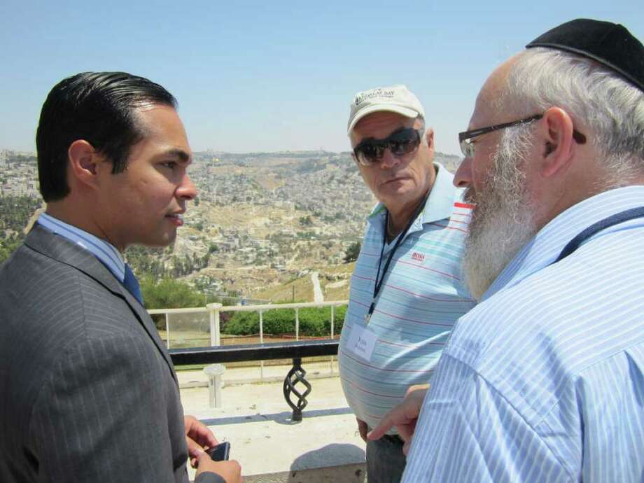 While in Israel, Mayor Julián Castro (from left) talks with Yuda Doliner of Sun Freedom America and Rabbi Chaim Block of Chabad Lubavitch of South Texas. Photo: Tracy Idell Hamilton/thamilton@express-news.net / © 2011 San Antonio Express-News