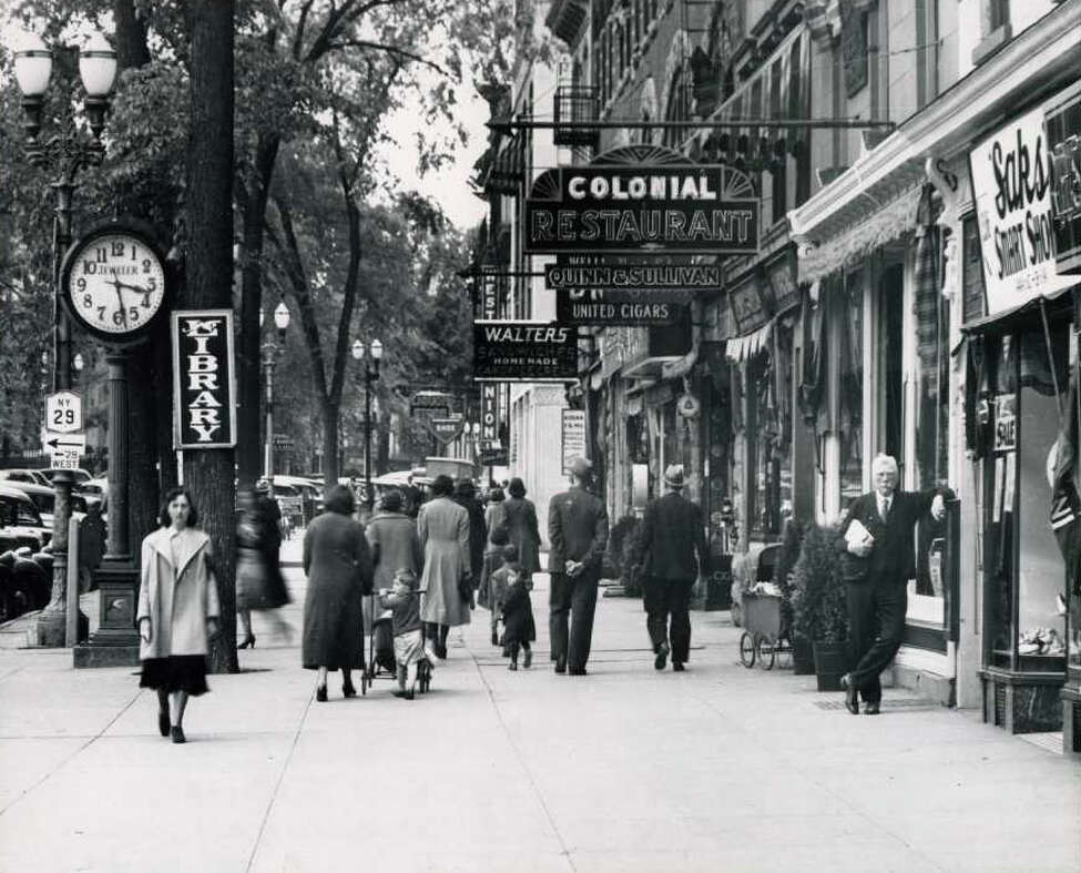 Keep clicking through the slideshow for historical photos of downtown Saratoga Springs. Broadway, between Spring and Phila Streets on May 26, 1938. Standing to the right is Thomas F. MacGovern. (Courtesy of Saratoga Springs Historical Museum, George S. Bolster collection)