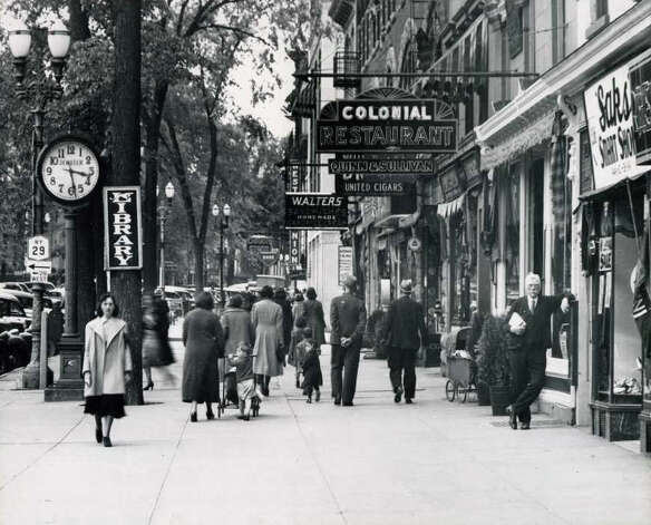 Broadway, between Spring and Phila Streets on May 26, 1938. Standing to the right is Thomas F. MacGovern. (Courtesy of Saratoga Springs Historical Museum, George S. Bolster collection)