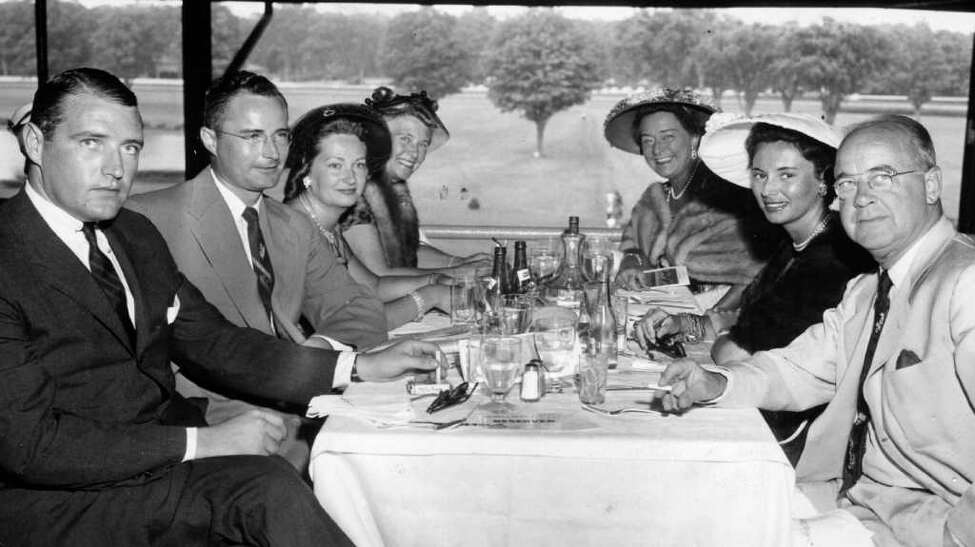 August 7, 1956 Saratoga Races (people attending) A new season at Saratoga Opening day at the Saratoga Race Track yesterday found many Albany residents lunching at the clubhouse and tyring their luck at the parimutuels windows. Among those in the clubhouse were, left to right on the near side of the table: Mrs. George Horohoe, Miami, and Mr. and Mrs. Richard Burke and William Fagan of Albany. On the far side, left to right, are: Mrs. Alfred Hurst, Mrs. William Fagan and Mr. Hurst. Mr. Fagan and Mr. Hurst are associated in the Capitol Buick Company. (The Knickerbocker News)