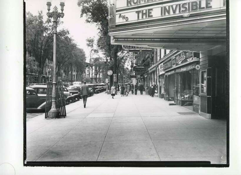 A look at Broadway from Spring Street in 1938. The marquee from the Congress Theater is visible. (Co