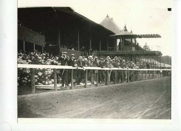 Railbirds watch the action during the 1919 meet at the Spa. Did all these guys go the same store to buy their hats? (Courtesy of Saratoga Springs Historical Museum, George S. Bolster collection)