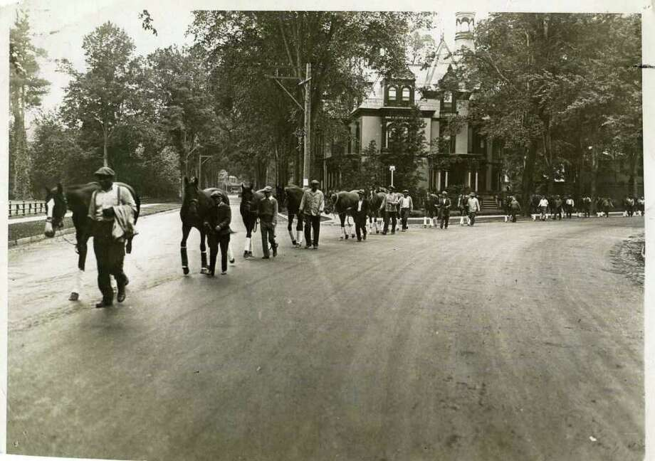 Horses are led up Circular Street (past the Batcheller Mansion) to the track on July 15, 1934. There were no horse vans back then ... all the horses came up from New York via train and then walked up to the track. (The Knickerbocker Press)