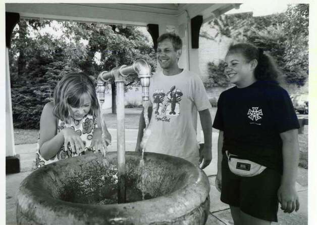Sara Roz from the Town of Saratoga, aged 10, shows how much she likes the Spa spring water at the Hathorn Spring on Spring Street on July 29, 1993. Her dad Steve, and 12-year-old sister Katie, think it's all pretty funny. (Paul D. Knickern Sr./Times Union)