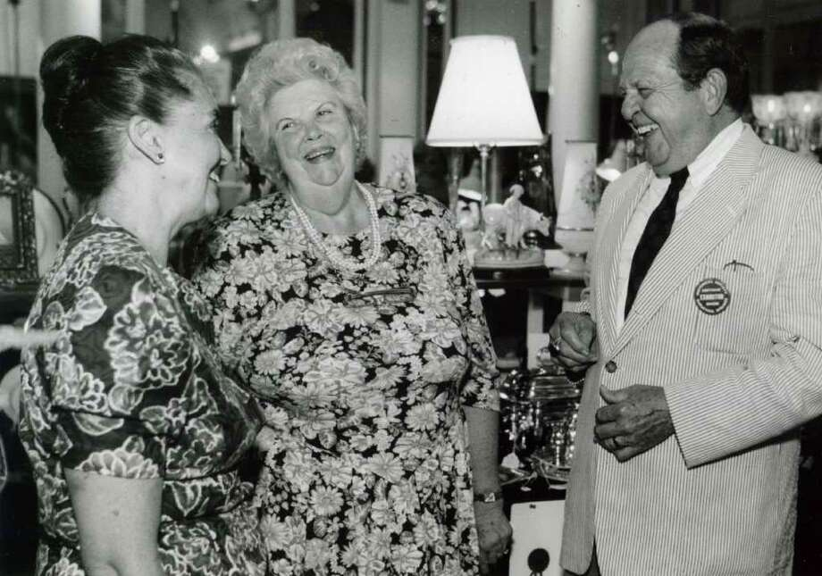 The annual Antique Show at the Canfield Casino, this version from Aug. 12, 1993. Pictured from the left are co-chairperson Remigia Foy, chairperson Minnie Bolster and Dr. B. Cullen Burris of Burris Antiques in Schenectady. (Steve Jacobs/Times Union)
