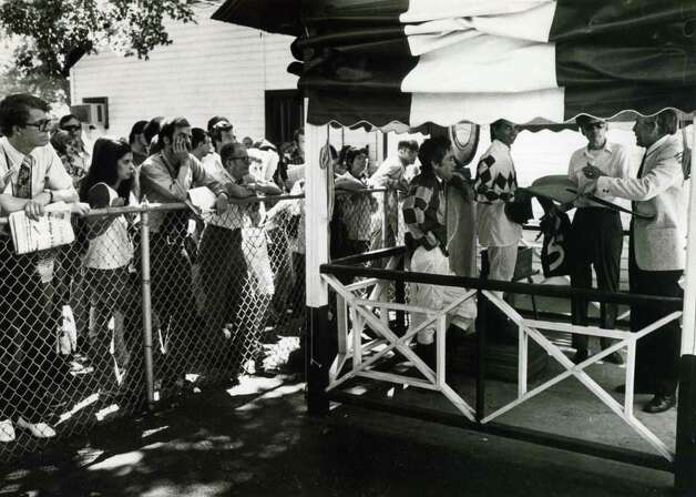 People always liked to watch the jockeys weigh in before the races. And, back in the day, they could do it all day. No date on this photo, but, the guy on the far left has a Racing Form with Riva Ridge in the headline. That would make it the early 1970s. (Times Union Archives)