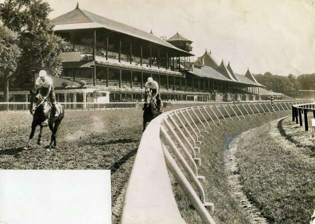 A couple of horses work out on the main track on July 31, 1959. (Times Union Archives)
