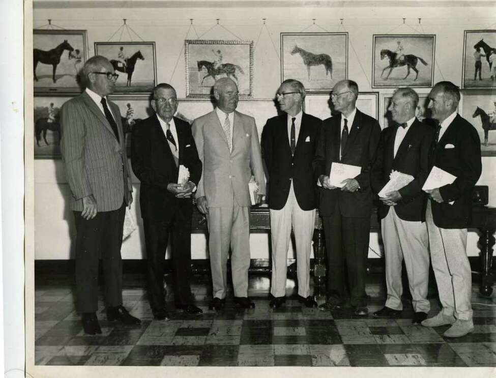 The 1970 induction class for the Saratoga National Museum of Racing and Hall of Fame. From left to right: Eddie Nelroy, trainer of Buckpasser, trainer Marion Van Berg, Ogden Phipps, owner/breeder of Buckpasser, Gerard S. Smith, Museum Vice-President who presented the awards, John A. Morris, who accepted for jockey Gil Patrick, jockey Frank Coltilletti and steeplechase jockey Frank Adams. (Courtesy of NYRA)