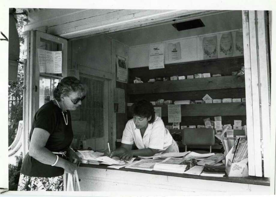 Laura Vega, right of Greenwich, gives Mrs. Robert Hubbell of Scotia some tips on Saratoga restaurants while working in the Spa's information booth near Congress Park on July 24, 1987.(Paul D. Kniskern Sr./Times Union)