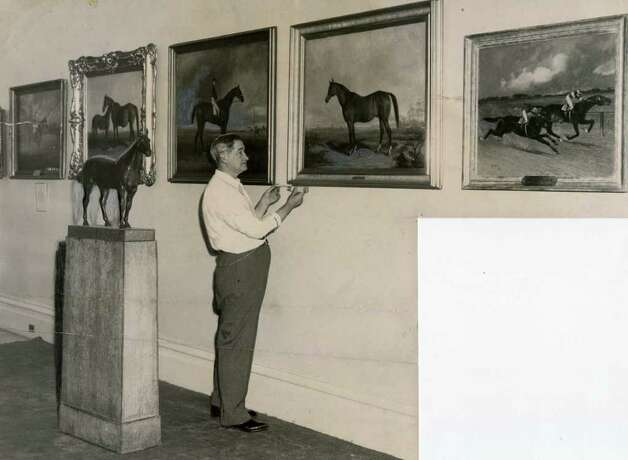 John Pastor of the National Museum of Racing and Hall of Fame, checks out a painting in on Aug. 6, 1951. (Times Union Archives)