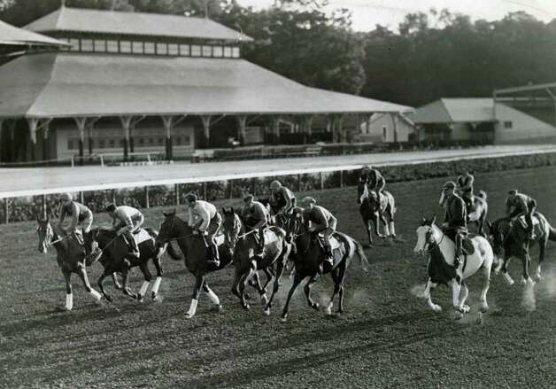 A big group of horses are out for their morning exercise at Saratoga on July 31, 1931. Notice that the exercise riders are not wering helmets. These days, they have to wear them and also flak jackets. (Times Union Archives)