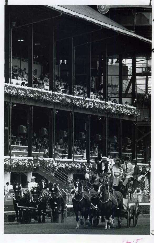 Members of high society used to come into the track on opening day in horse drawn carriages, like this parade on July 31, 1986.  (Skip Dickstein/Times Union)