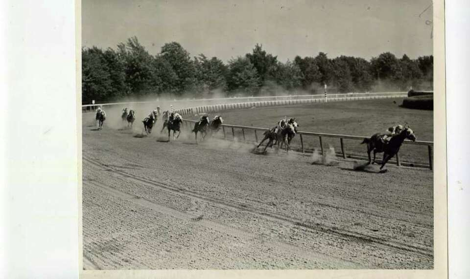 The hoses head for home in a claiming race for 3-year-olds on Aug. 4, 1938. The winner of the race,