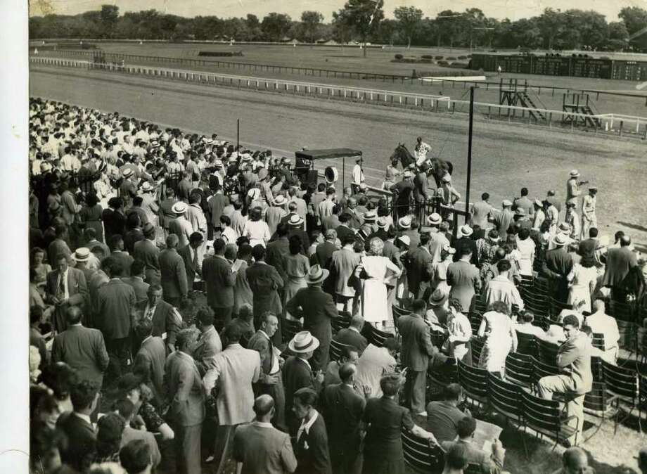 The crowd at the races on Aug. 6, 1946. Most people are pretty gussied up.  (Times Union Archives)