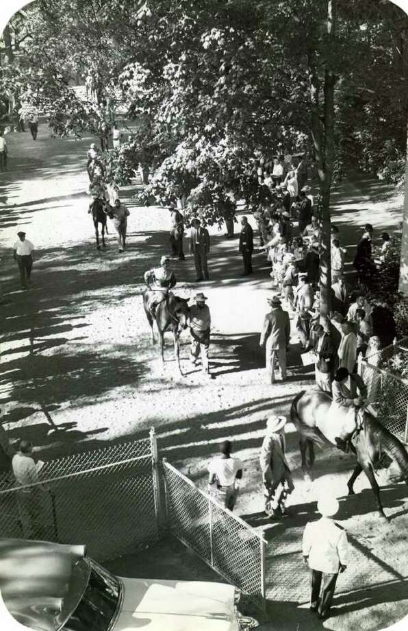 Horses head to the track from the paddock for one of the first races of the 1953 meet. The 85th season opened on Aug. 4, 1953.  (Times Union Archives)