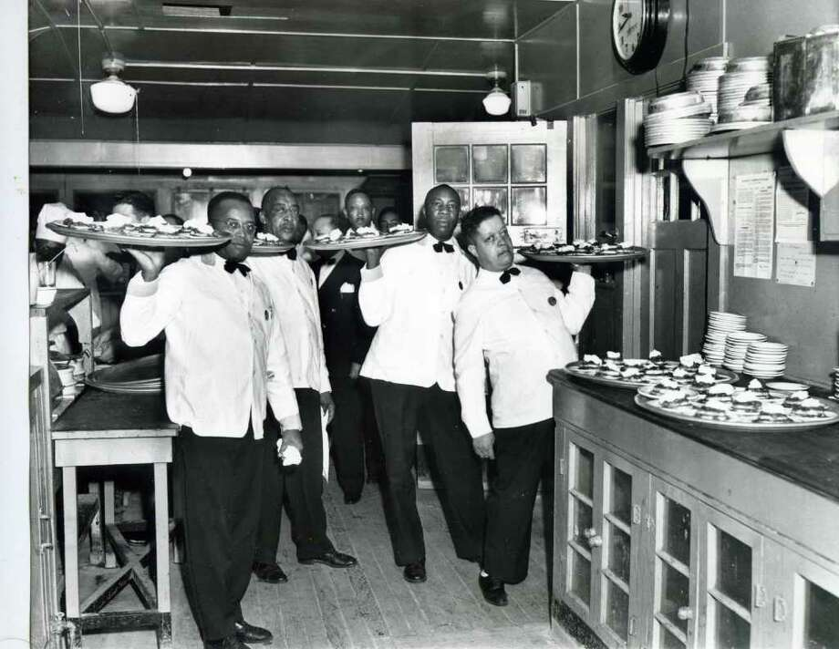 The staff of waiters at Newman's Lake House on Oct. 26, 1947. Looks like they're serving dessert. . (Courtesy of Saratoga Springs Historical Museum, George S. Bolster collection)