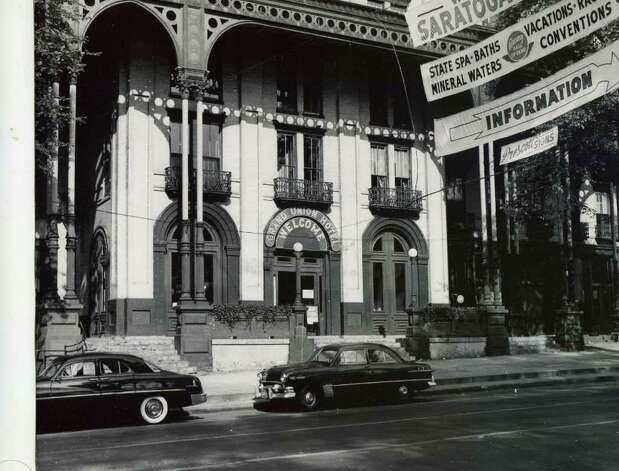 The front of the Grand Union Hotel. The photo is not dated, but judging by the cars, it looks like the early 1950s. The banners hanging over the street would indicate it was racing season. (Courtesy of Saratoga Springs Historical Museum, George S. Bolster collection)