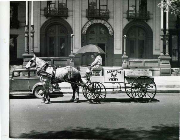 A delivery man for Saratoga Vichy Water makes the rounds in front of the Grand Union Hotel on Broadway on May 7, 1944. (Courtesy of Saratoga Springs Historical Museum, George S. Bolster collection)