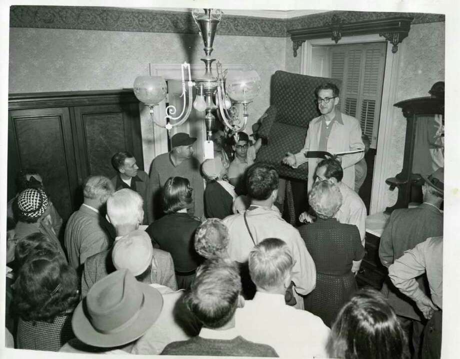 Looks like someone is holding an auction at the Grand Union Hotel. The date is Sept. 22, 1952. That's the year the big hotel closed its doors forever. (Times Union Archives)