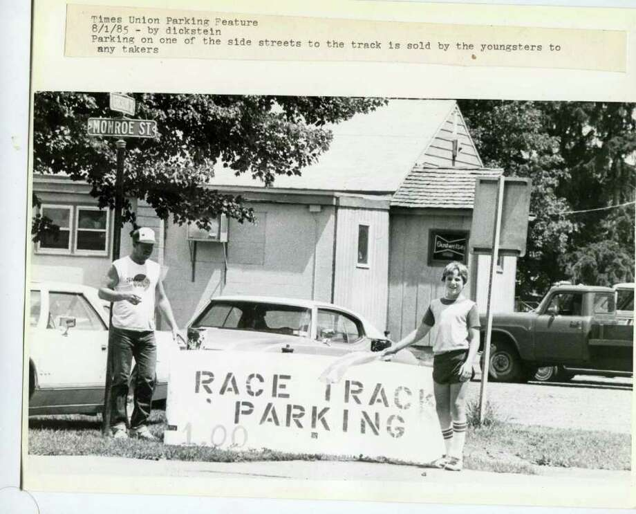 My, how times have changed. Back on Aug. 1, 1985, it only cost a buck to park on this lawn. Can't find that anywhere today, unless you're willing to park in Schuylerville. (Skip Dickstein/Times Union)