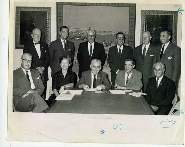 Here is the Saratoga Thoroughbred Racing Centennial Board of Directors at a meeting at the National Museum of Racing on Aug. 3, 1963. Seated, left to right, are James H. Minnick, superintendent of the Department of Public Works, Glens Falls; Mrs. Elaine E. Mann, executive secretary of the Hall of Fame; Arthur J. Kearney, chairman, Saratoga businessman; Fred Eaton, president and editor of The Saratogian and Angelo J. Tarantino, Saratoga businessman. Standing, from left to right, are F. Skiddy vonStade, trustee, New York Racing Association; John S. Wyld, director of regional offices, State of New York Department of Commerce; the Honorable John L. Ostrander of Schuylerville; Demetrios A. Sazani, executive director; Howell E. Jackson, trustee, New York Racing Association and Newman Wait Jr., treasurer and executive vice president of the Adirondack Trust Company. (Times Union Archives)