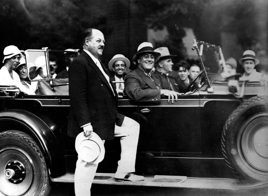 Then New York State Gov. Franklin Delano Roosevelt and Eleanor Roosevelt visited the Saratoga Race Course in 1931. Posed on the running board is George H. Bull, president of the then- Saratoga Racing Association. From the George S. Bolster Collection of the Historical Society of Saratoga Springs. / ALBANY TIMES UNION