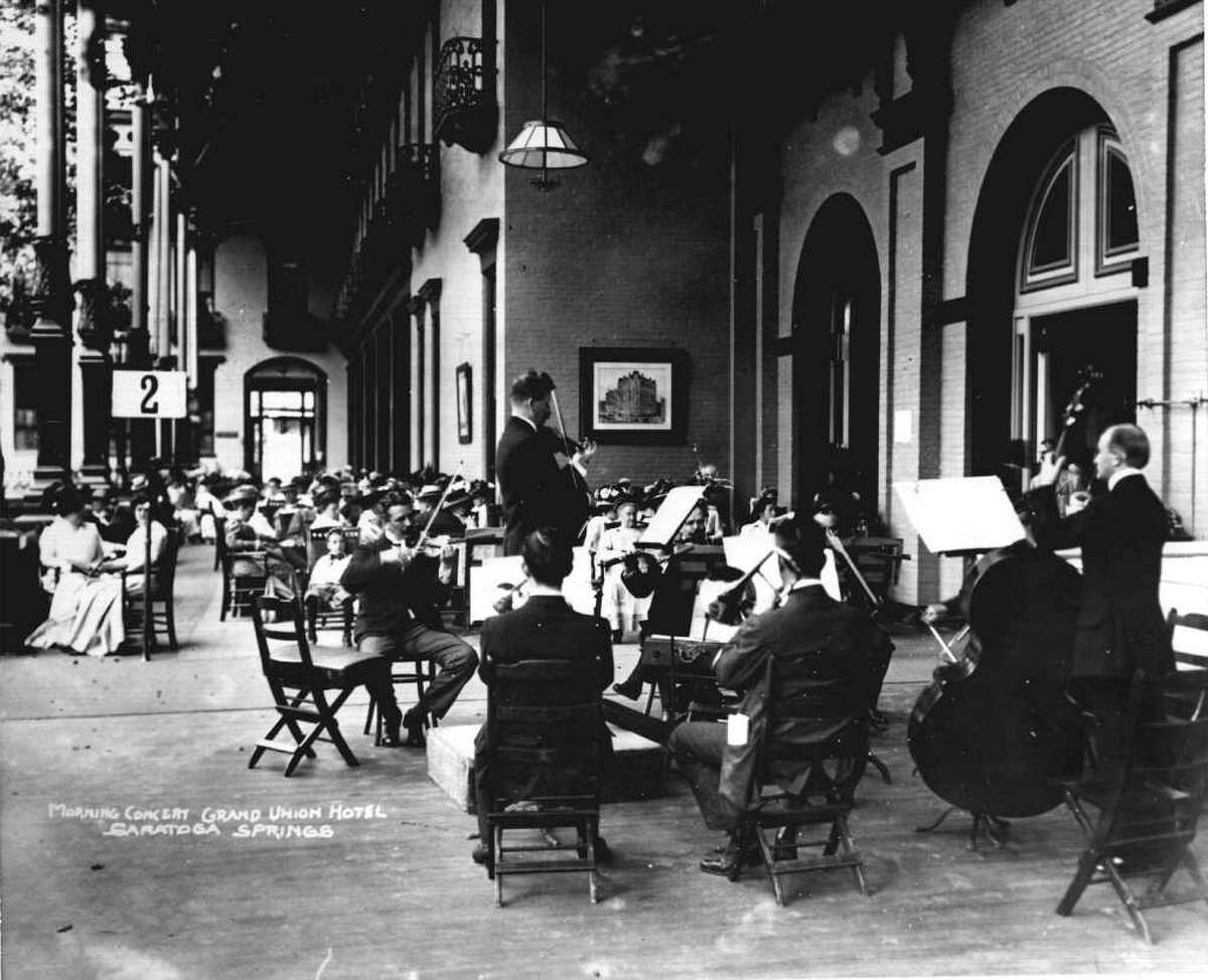 VICTOR HERBERT PLAYS VIOLIN AND LEADS A 1900 MORNING CONCERT AT THE GRAND UNION HOTEL IN SARATOGA SPRINGS.--PHOTO COURTESY OF THE GEORGE S. BOLSTER COLLECTION OF THE HISTORICAL SOCIETY OF SARATOGA SPRINGS.
